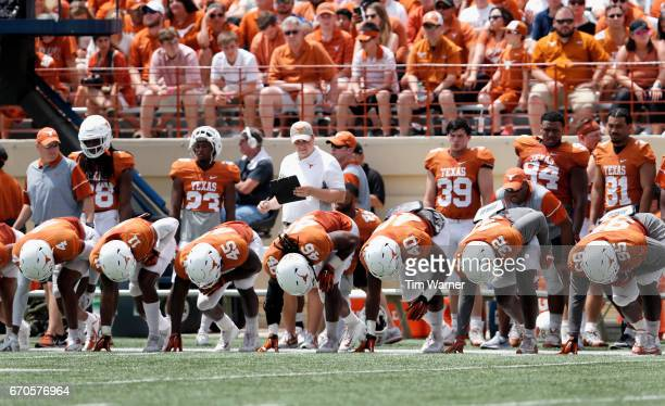 The Texas Longhorns first team defense lines up to sprint onto the field before a series during the OrangeWhite Spring Game at Darrell K RoyalTexas...