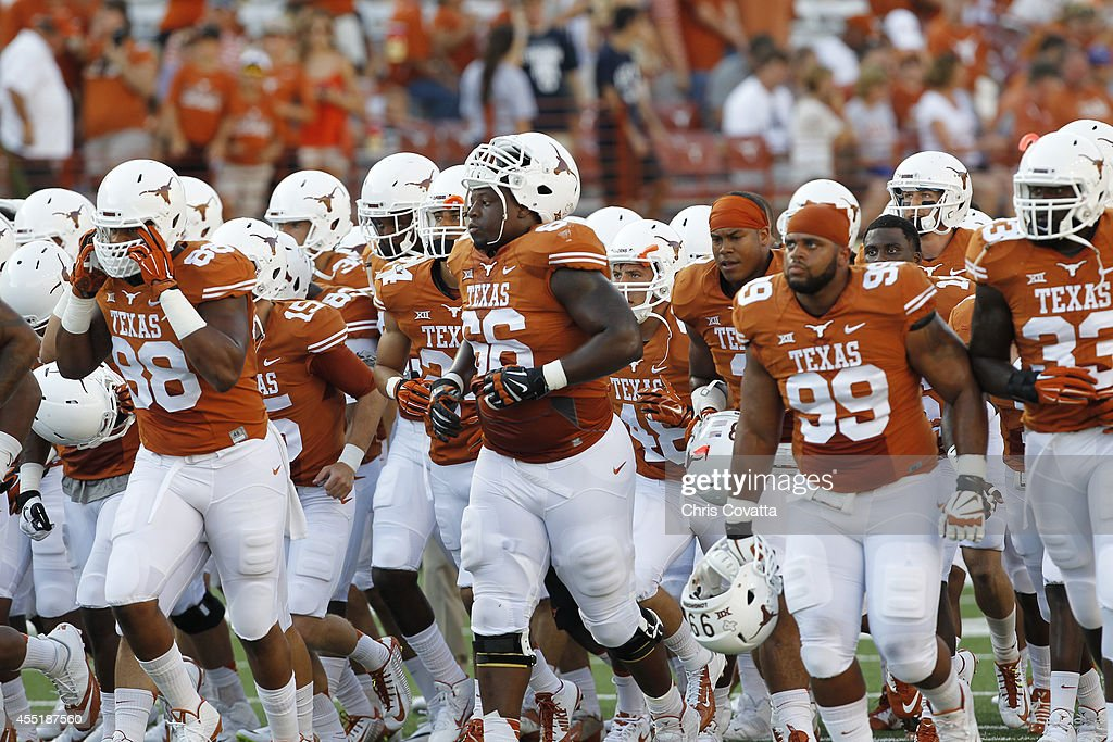 The Texas Longhorns leave the field after warmups before playing the BYU Cougars on September 6 2014 at Darrell K RoyalTexas Memorial Stadium in...