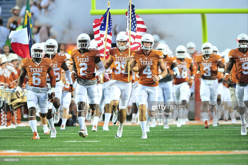the Texas Longhorns take the field before kickoff against the Iowa State Cyclones on October 18 2014 at Darrell K RoyalTexas Memorial Stadium in...