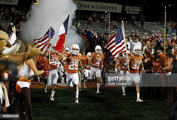 The Texas Longhorns take the field before playing the TCU Horned Frogs at Darrell K Royal Texas Memorial Stadium on November 27 2014 in Austin Texas