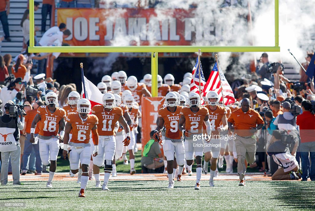 The Texas Longhorns take the field before the NCAA Big 12 game between the Texas Longhorns and the West Virginia Mountaineers on November 8 2014 at...