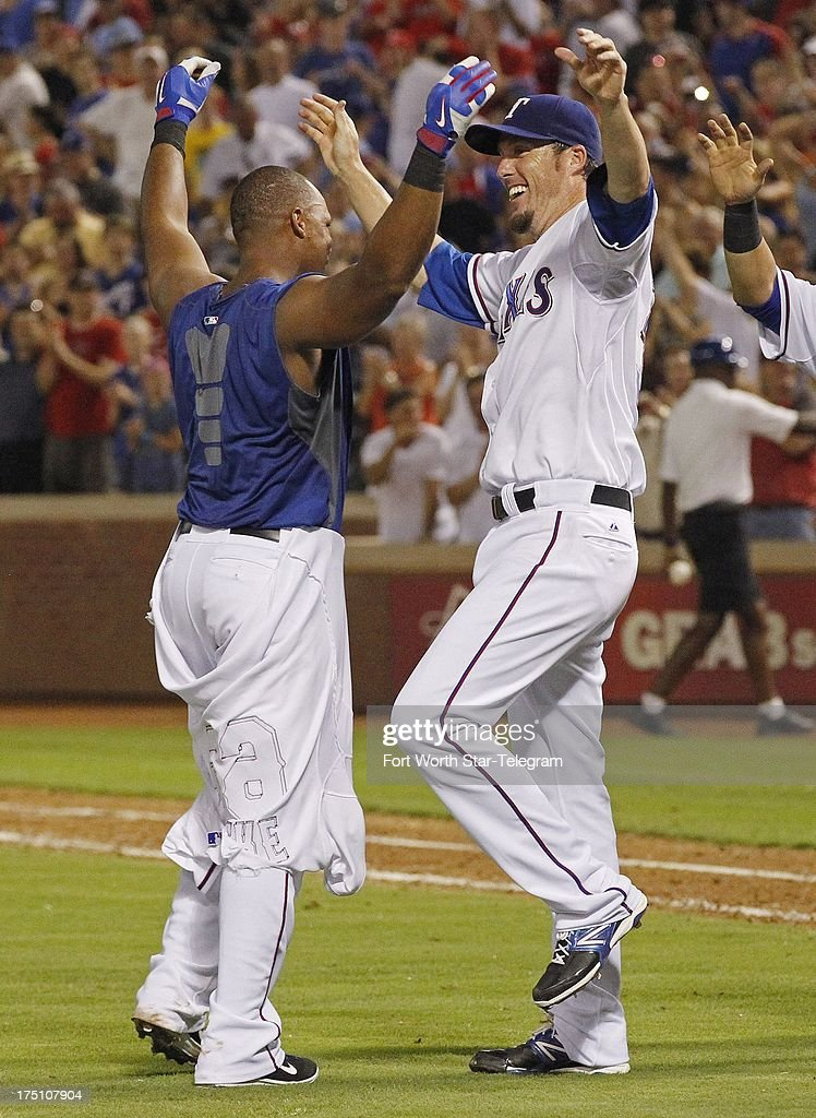 The Texas Rangers' Adrian Beltre, left, celebrates with winning pitcher Joe Nathan after Beltre hit a walk-off home run against Los Angeles Angels at the Rangers Ballpark in Arlington on Wednesday July 31, 2013, in Arlington, Texas. The Rangers won, 2-1.
