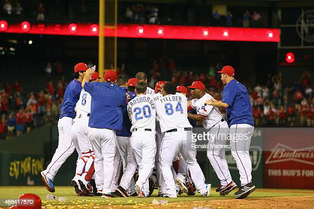 The Texas Rangers celebrate a walkoff single by Mitch Moreland against the Houston Astros at Globe Life Park in Arlington on September 15 2015 in...