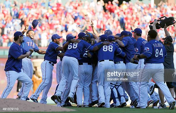 The Texas Rangers celebrate winning the AL West title after a baseball game against the Los Angeles Angels at Globe Life Park on October 4 2015 in...