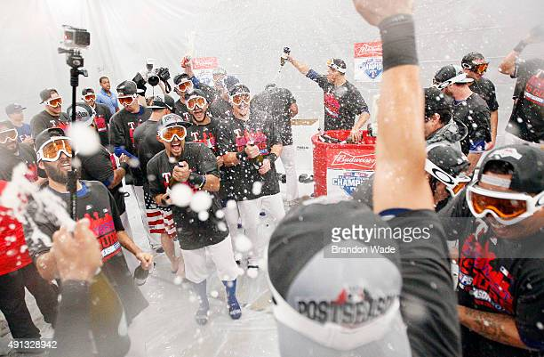 The Texas Rangers celebrate winning their sixth AL West Title after a baseball game against the Los Angeles Angels at Globe Life Park on October 4...