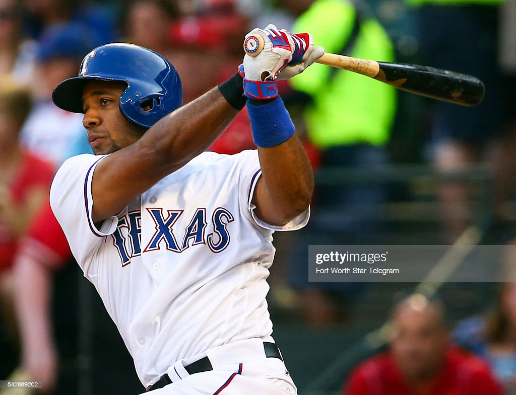 The Texas Rangers' Elvis Andrus hits a two-run single in the first inning against the Boston Red Sox at Globe Life Park in Arlington, Texas, on Friday, June 24, 2016.