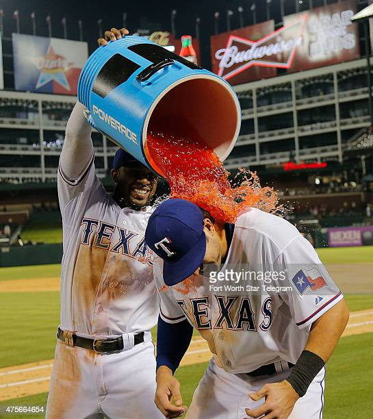 The Texas Rangers' Elvis Andrus left gives third baseman Joey Gallo a sports drink bath after a 152 win against the Chicago White Sox at Globe Life...