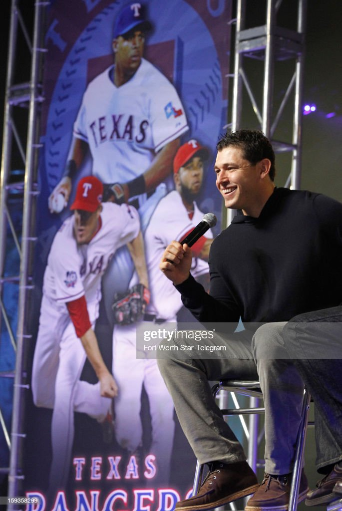The Texas Rangers' Ian Kinsler answers fans' questions near a mural of his teammates at the team's Fan Fest in the Arlington Convention Center on Saturday, January 12, 2013, in Arlington, Texas.