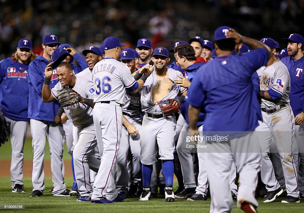 The Texas Rangers, including Adrian Beltre #29 and Rougned Odor #12, celebrate after they clinched the American League West Division Title by beating the Oakland Athletics at Oakland-Alameda County Coliseum on September 23, 2016 in Oakland, California.