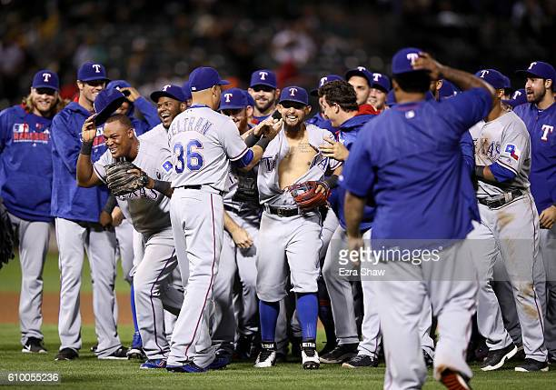 The Texas Rangers including Adrian Beltre and Rougned Odor celebrate after they clinched the American League West Division Title by beating the...