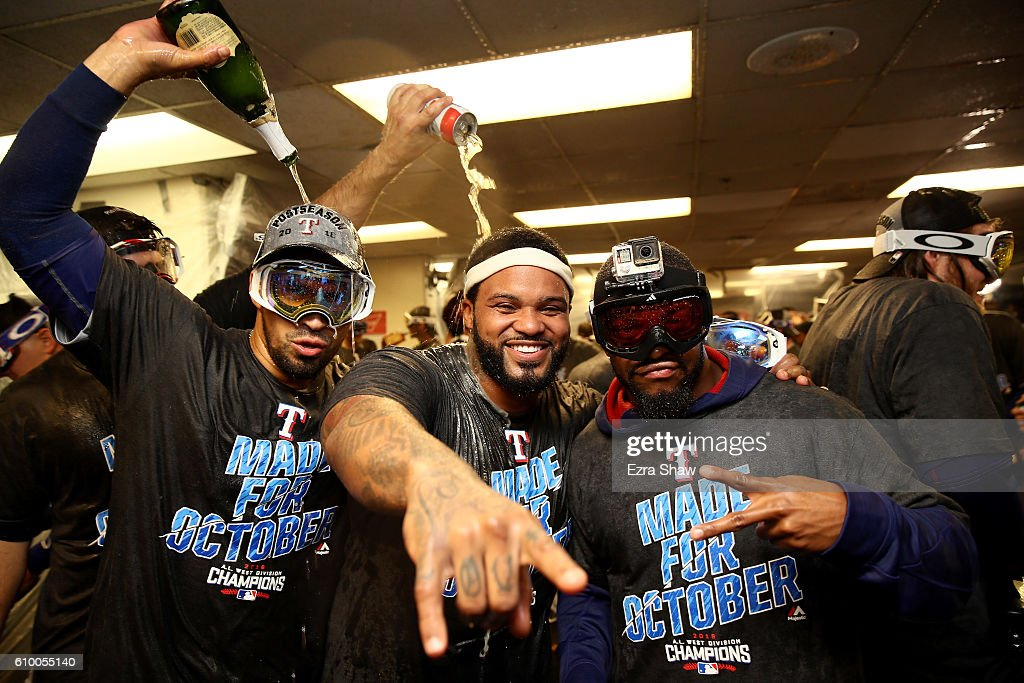 The Texas Rangers, including Prince Fielder in the center, celebrate in the lockerroom after they clinched the American League West Division Tital at Oakland-Alameda County Coliseum on September 23, 2016 in Oakland, California.