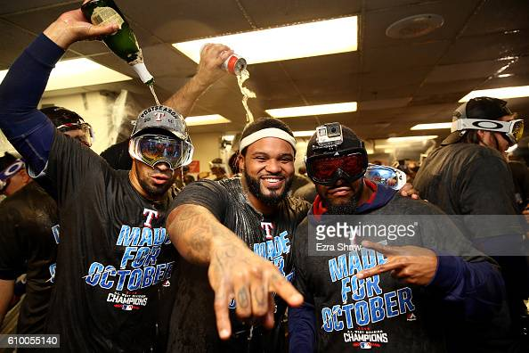 The Texas Rangers including Prince Fielder in the center celebrate in the lockerroom after they clinched the American League West Division Tital at...