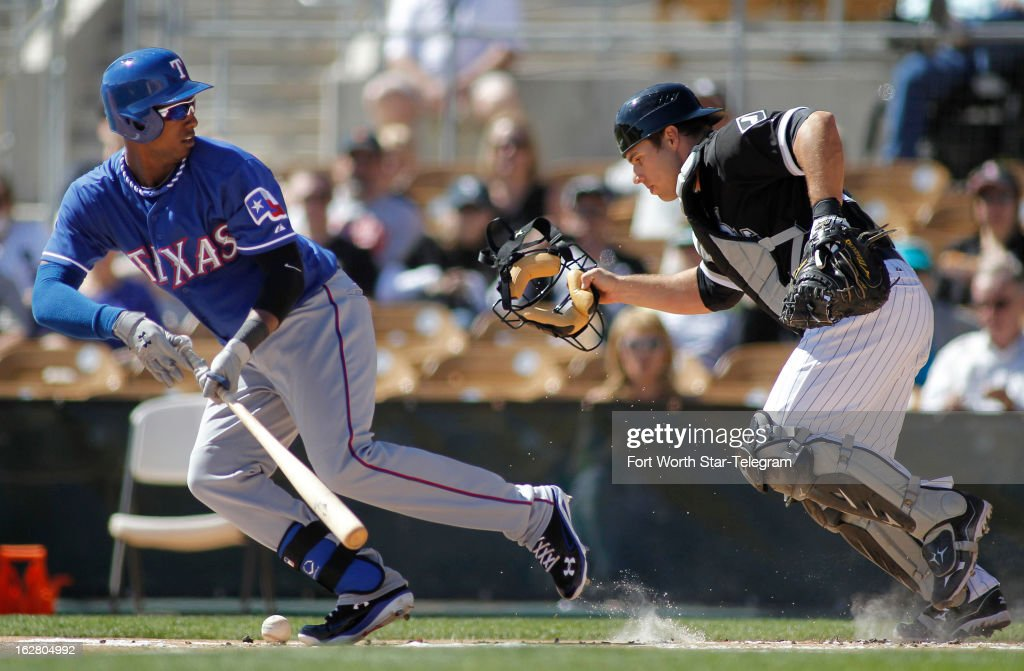 The Texas Rangers' Jurickson Profar, left, looks back at Chicago White Sox catcher Josh Phegley as Phegley scrambles for the ball at Profar's feet in the first inning in Glendale, Arizona, Wednesday, February 27, 2013. Chicago won, 8-4.