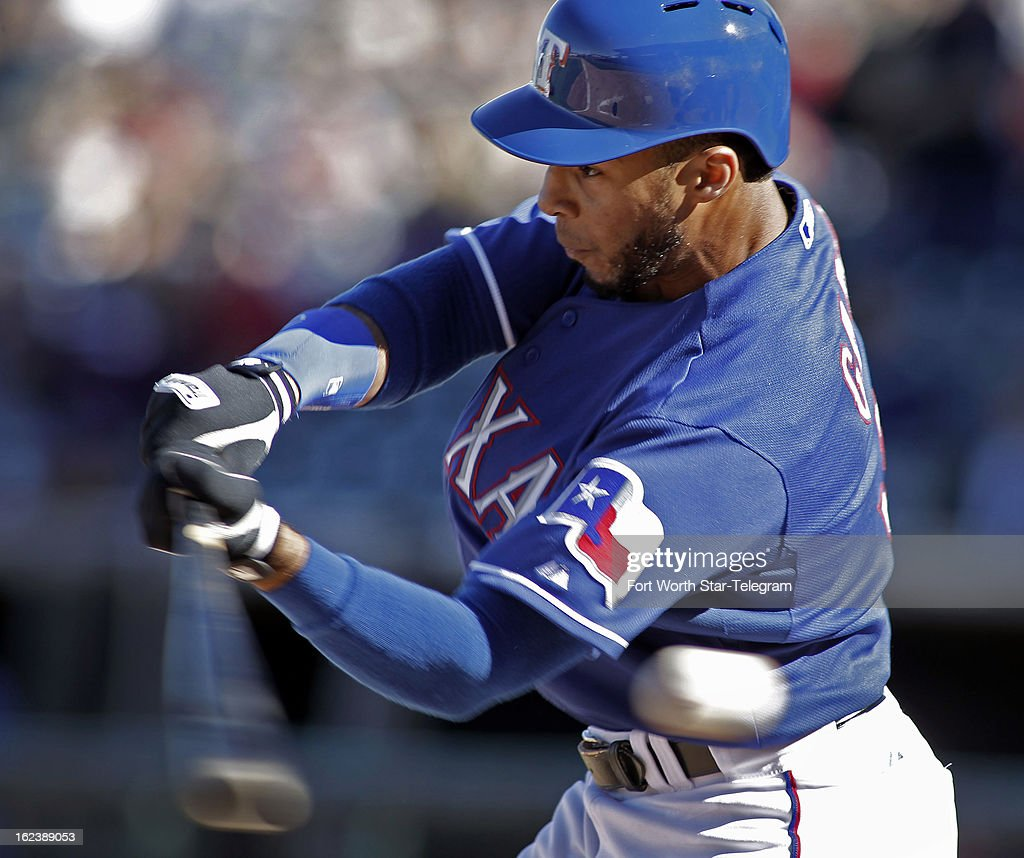 The Texas Rangers' Leury Garcia swings at a strike pitch during a spring training game against the Kansas City Royals in Surprise, Arizona, Friday, February 22, 2013. The game finished in a 5-5 tie.