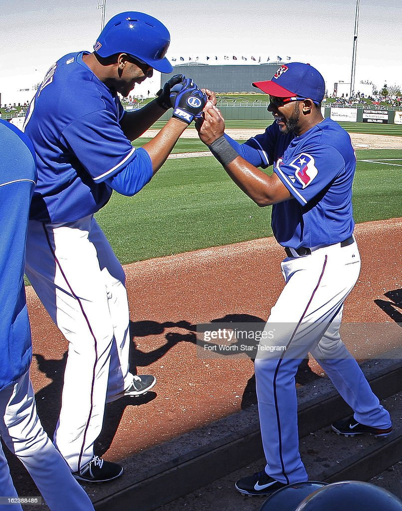 The Texas Rangers Nelson Cruz, left, is greeted by teammate Elvis Andrus at the dugout following his two-run home run against the Kansas City Royals in the fourth inning of a spring training game in Surprise, Arizona, Friday, February 22, 2013. The game ended in a 5-5 tie.