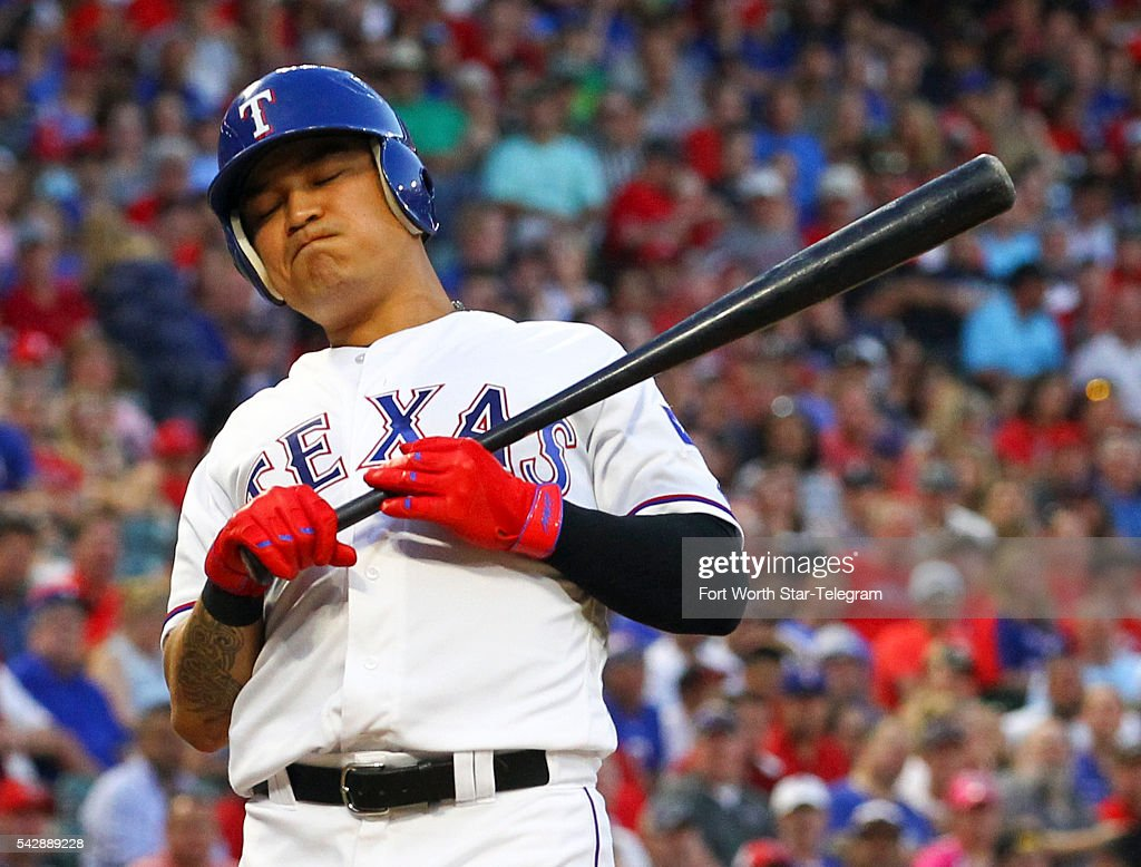 The Texas Rangers' Shin-Soo Choo reacts after being hit by a pitch by Boston Red Sox pitcher Matt Barnes in the third inning at Globe Life Park in Arlington, Texas, on Friday, June 24, 2016.