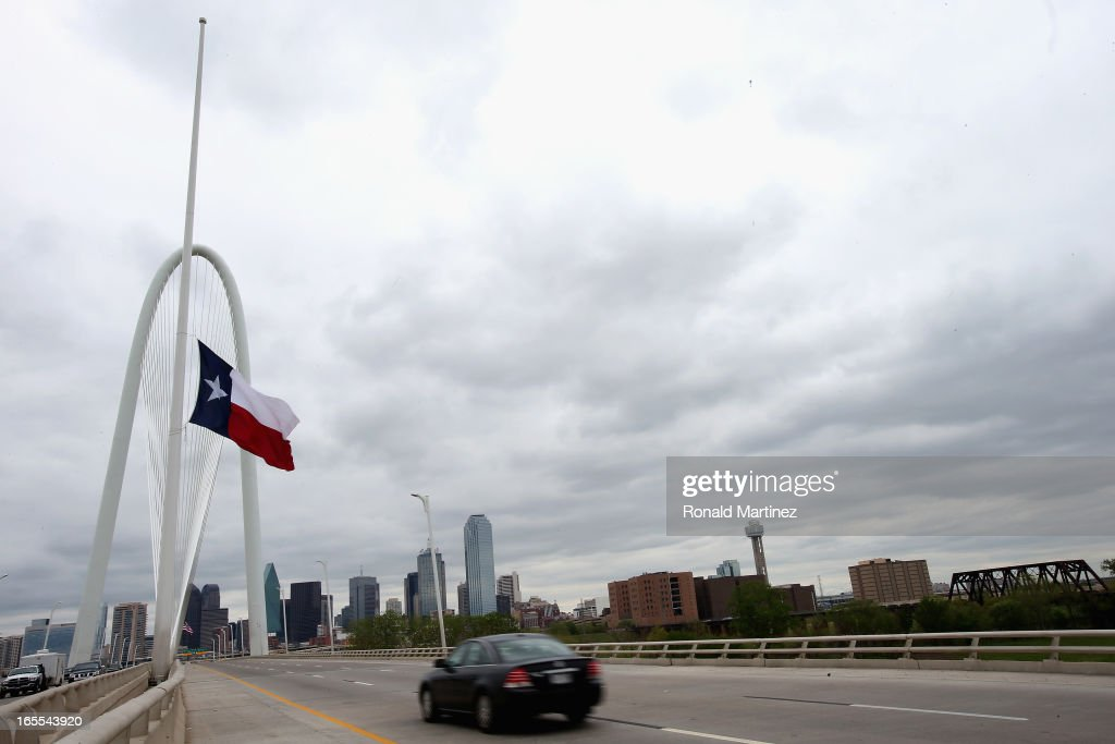 The Texas state flag flies at half staff at the Margaret Hunt Hill Bridge April 4, 2013 in Dallas, Texas. The flag was flown at half staff on the day a memorial was held for Kaufman County District Attorney Mike McLelland and his wife Cynthia, who were shot and killed in their home about 20 miles east of Dallas over the weekend.