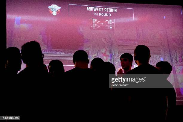 The Texas Tech Red Raiders gather around the television screen during the 2016 Texas Tech Men's Basketball Team Selection Sunday Watch Party on March...