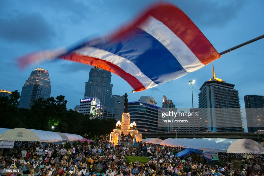 The Thai national flag blows in the wind as hundreds of anti-government protesters gather for a rally on August 4, 2013 in downtown Bangkok, Thailand. They came together to protest against the current government of Prime Minister Yingluck Shinawatra and former Prime Minister Thaksin Shinawatra, who has been living in self-imposed exile. The anti-government group has named itself the 'People's Army' which is a coalition of ultra-royalist and nationalist groups.