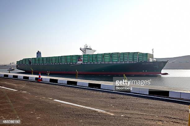 The Thalassa Avra container ship passes through the New Suez Canal operated by the Suez Canal Authority during the official opening ceremony in...