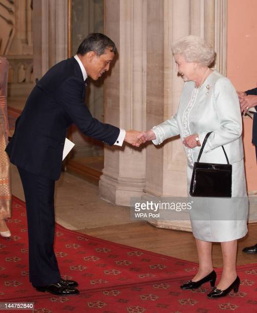 The the Crown Prince of Thailand Maha Vajiralongkorn is greeted by Queen Elizabeth II at lunch For Sovereign Monarchs in honour of Queen Elizabeth...