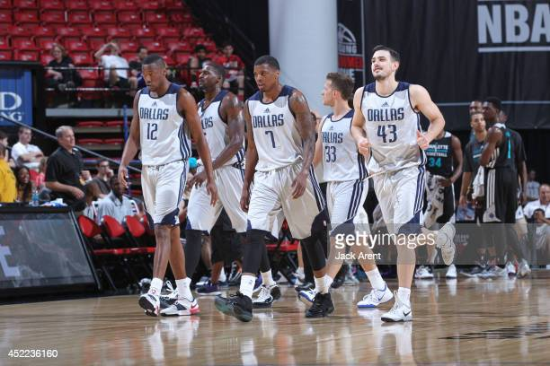 The the Dallas Mavericks walk onto the court during the game against the Charlotte Hornets at the Samsung NBA Summer League 2014 on July 16 2014 at...