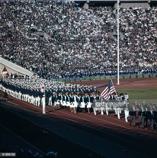 The The United States Olympic team enters the field to join the parade of Nations during the opening ceremonies for the XVIII Olympiad at the Olympic...