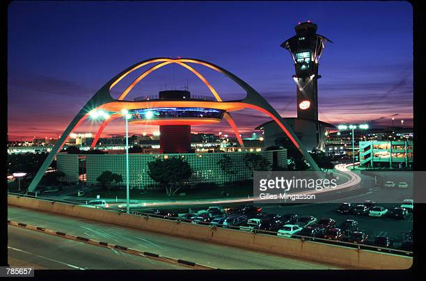 The Theme Building at Los Angeles International Airport stands illuminated at dusk near the tower December 15 1997 in Los Angeles CA A primary goal...