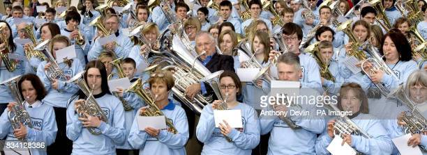 The theme tune of Australian soap Neighbours is performed by star Ian Smith along with hundreds of brass band musicians from around the UK to...