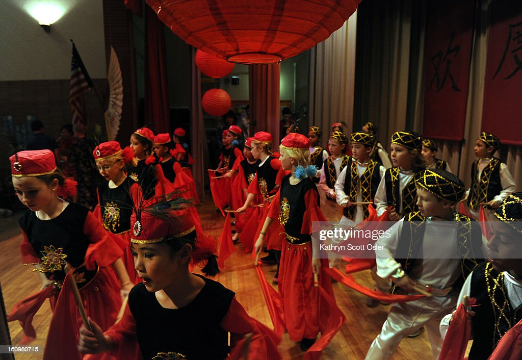 The third grade performs the Xinjiang (Uyghur) Dance. Students at the Denver Language School ring in the Year of the Snake with their Chinese New Year celebration performance in the school auditorium. Kindergarteners through 4th grade perform traditional dances dressed in colorful Chinese costumes. According to the school principal, Chinese New Year is the most important of the traditional Chinese holidays. Families make way for good luck by cleaning their homes symbolizing reconciliation and forgetting old grudges in exchange for peace and happiness. The Chinese New Year (Feb. 10) follows the Chinese 12 Zodiac Calendar Year designating 2013 the Year of the Snake.