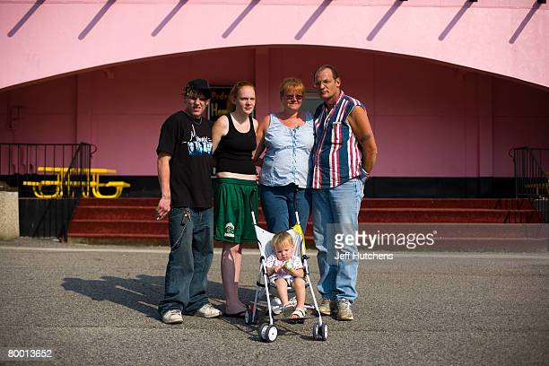 The Thogode family takes a break for ice cream cones on a New York to Florida haul at the ice cream shop at South of the Border on July 21 2006 in...