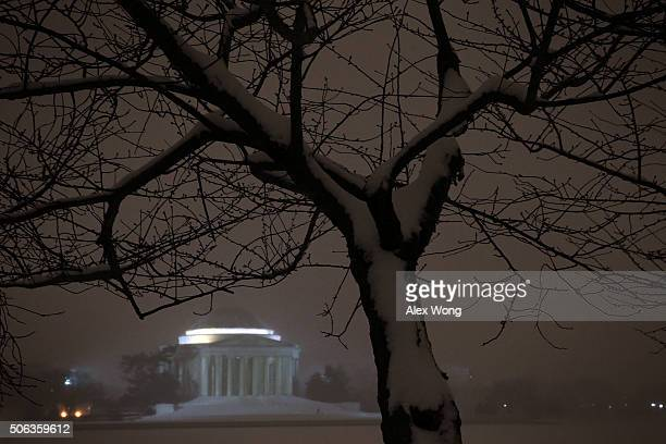 The Thomas Jefferson Memorial sits in the snow January 22 2016 in Washington DC A winter snowstorm is forecasted for the East Coast this weekend with...