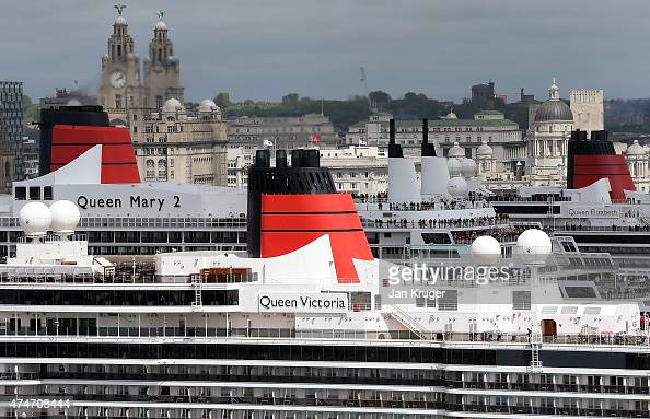 The three Cunard Queens Queen Mary 2 Queen Elizabeth and Queen Victoria meet on the River Mersey for the first time on May 25 2015 in Liverpool...