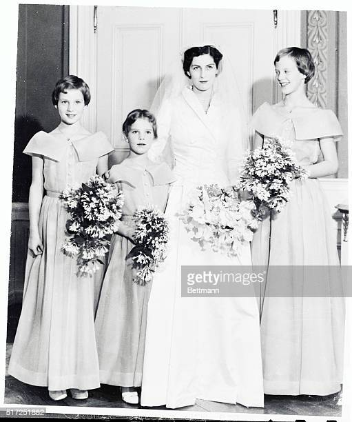 The three Danish princesses acted as bridesmaids when their British governess Mary North was married in 1954 to Mogens Hartung At the ceremony in...