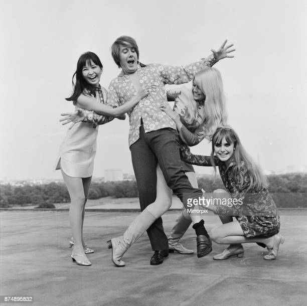 The three girls who star in the comedy film The Mini Mob left to right Lucille Soong Gretchen regan and Madeline Smith photographed with BBC disc...