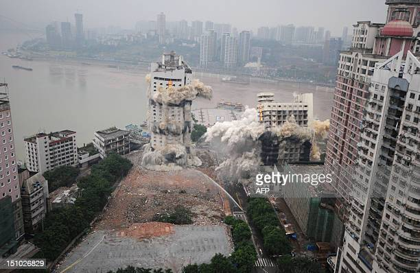 The Three Gorges Hotel and the 32storey passenger terminal of Chongqing port are toppled in a controlled explosion to make way for new skyscrapers in...