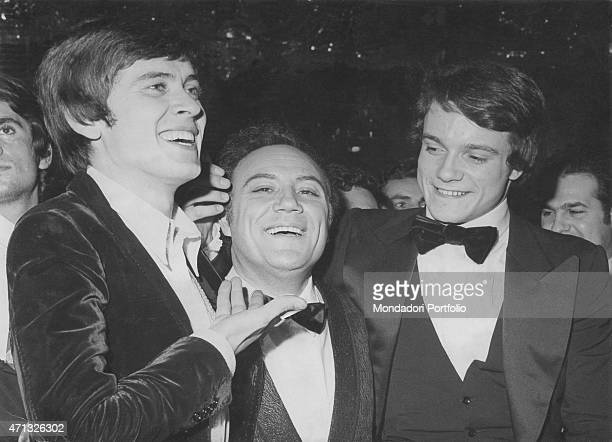 The three Italian singers Gianni Morandi Claudio Villa and Massimo Ranieri smiling before the final round of the variety music show Canzonissima...