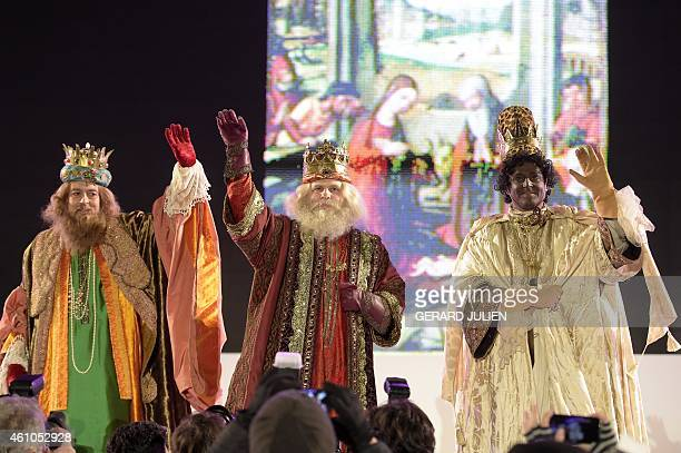 The Three Kings wave at the end of the Three Kings parade in Madrid on January 5 2015 Every year on January 5 children and parents can see horses...