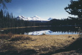 The Three Sisters peaks as seen from Scott Lake Oregon USA circa 1960