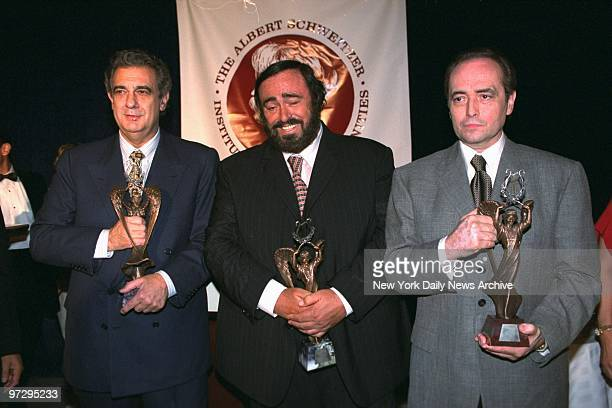 The Three Tenors Placido Domingo Luciano Pavarotti and Jose Carreras hold their Albert Schweitzer Music Awards after presentations at the...