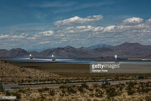 The three towers at the Ivanpah Solar Electric Generating System are shown in operation on May 17 2015 in the Mojave Desert in California south of...