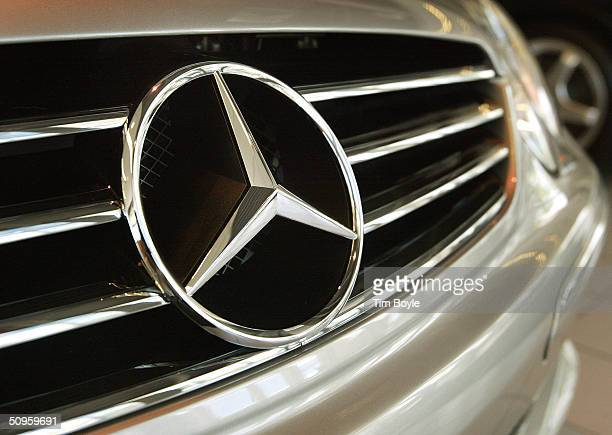 The threepointed star MercedesBenz emblem is seen on the grille of a sedan in the showroom of MercedesBenz of Hoffman Estates June 14 2004 in Hoffman...