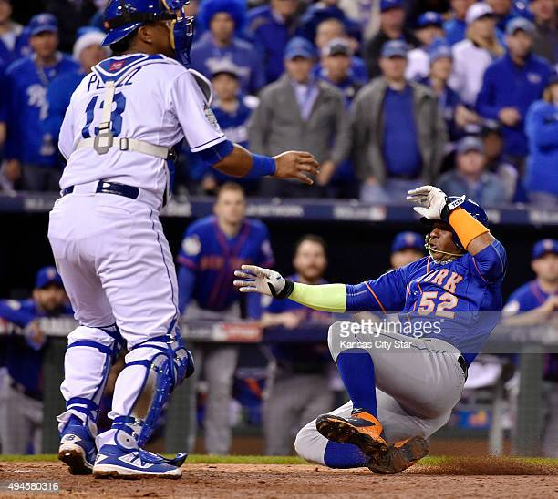 The throw from Kansas City Royals left fielder Alex Gordon is too late to catcher Salvador Perez left allowing the New York Mets' Yoenis Cespedes to...