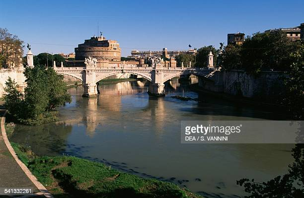 The Tiber river and the Vittorio Emanuele II bridge with Castel Sant'Angelo in the background Rome Lazio Italy