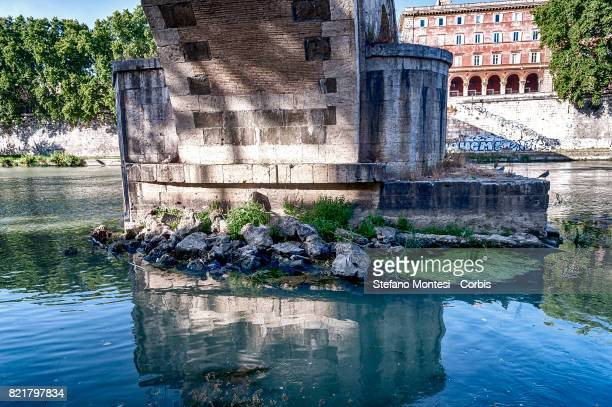 The Tiber River under Sisto Bridge with the low water level due to the drought on July 24 2017 in Rome Italy Because of the drought the ACEA which...