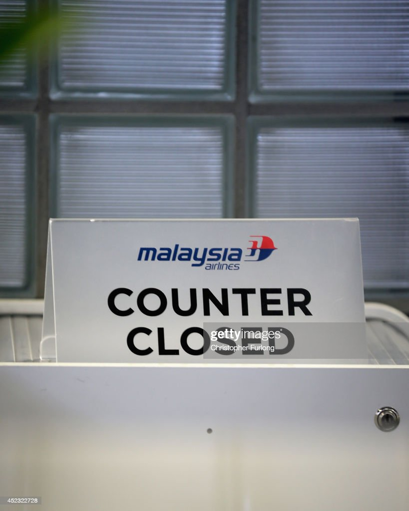 The ticketing desk of Malaysia Airlines remains closed at Schiphol Airport on July 18 2014 in Amsterdam Netherlands Malaysia Airlines flight MH17...