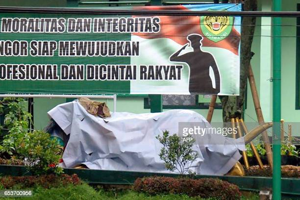 The tiger statue in front of a military base in Bandung is covered up on March 16 2017 after the Indonesian military removed the grinning cartoonlike...