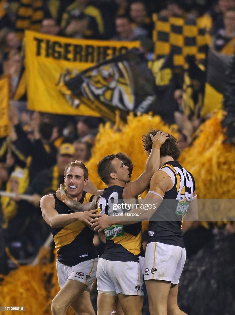The Tigers celebrate after Daniel Jackson kicked a goal in the final quarter during the round 13 AFL match between the Western Bulldogs and the Richmond Tigers at Etihad Stadium on June 22, 2013 in Melbourne, Australia.