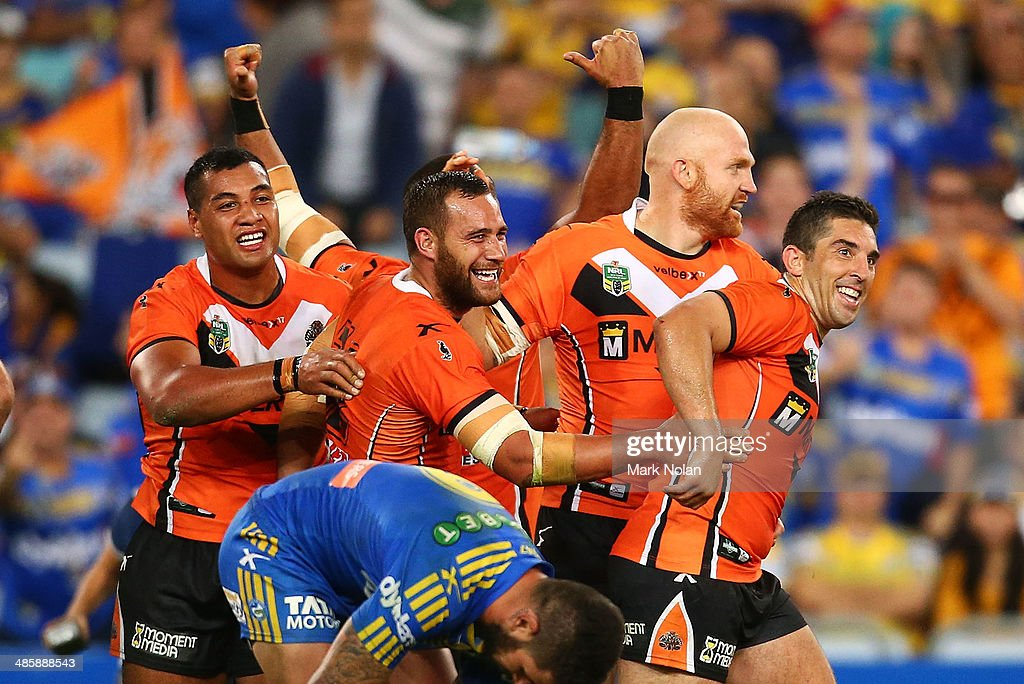 The Tigers celebrate winning the round seven NRL match between the Parramatta Eels and the Wests Tigers at ANZ Stadium on April 21, 2014 in Sydney, Australia.