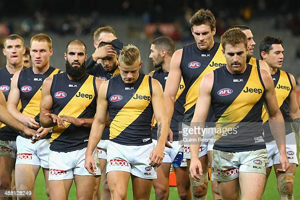 The Tigers look dejected as they leave the ground after losing the round seven AFL match between the Geelong Cats and the Richmond Tigers at...